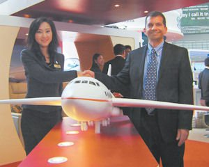 Partners: Sino Jet Management Ltd. CEO Jenny Lau with TWC's Andrew Richmond.