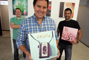 From left, Steve Bull, Matt Munson and Kevin Fremon with Instagram photos at Instacanvas in Santa Monica.