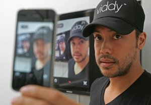 Co-founder JJ Aguhob records himself on a phone at Viddy's office in Venice.