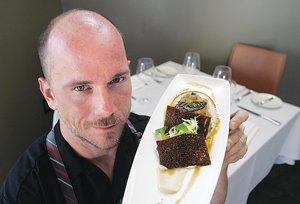 Chef Quinn Hatfield with foie gras.