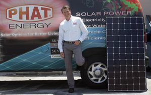 Philippe Hartley, Phat Energy general manager, with one of the La Crescenta company's vehicles.
