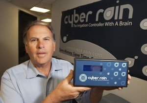 CEO James Krug with controller at Cyber Rain's office in Encino.