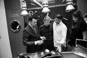 Kiril Sprostranov, left, Christopher Adams, Claudio Canive and Leyla Larijani look over a catalog during the recent party to kick off watchmaker Officine Panerai's La Jolla boutique.