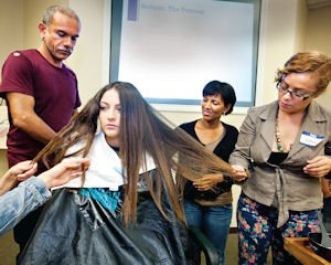 Cosmetologists at Zerran International learn to use the firm's hair straightening products.