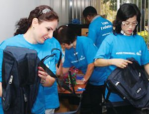Support: Kaiser Permanente employees stuffed backpacks with school supplies in Pasadena to be donated to children in the San Fernando Valley.