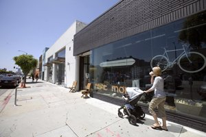 Storefronts along the west side of La Brea Avenue between First and Second streets.