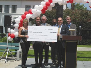 Michael Cunningham, dean of SDSU's College of Business Administration, received a donation of $150,000 from Professor Steven Osinski and his wife Ellen Osinski for the sales specialization program. The 3M Co. made a $100,000 grant to the program.
