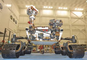 Malin Space Science Systems cameras are nested in several places on the Mars Curiosity rover including inside the mast rising on the left of the rover.