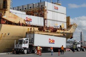From ship to truck: A crew positions a Dole shipping container to continue its journey over land. Dole's newly signed lease may keep the company at the Port of San Diego through 2036.