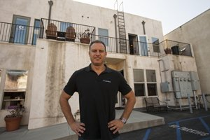 Eric Cohen, owner of Computer Smarts, at his El Segundo parts and repair business where he hopes to someday access solar energy.