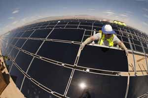 Worker assembles solar panels at Antelope Valley Solar Ranch One.
