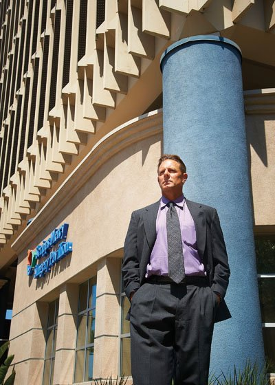 Stephen Dok, vice president in the San Diego health care division of brokerage firm Voit Real Estate Services, stands in front of the Scripps Mercy Hospital San Diego at 550 Washington St. Dok says that hospital-adjacent medical buildings are the preferred venue for many doctors, but that providers can expect to pay 15 percent to 20 percent premiums in rents for locations next to a hospital.