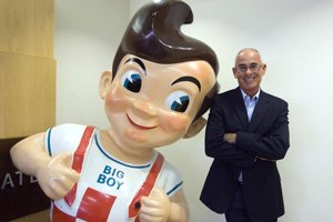 Bob Champion at his real estate firm's West L.A. headquarters with a Bob's Big Boy statue from a Glendale restaurant property he redeveloped.