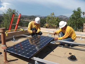 A crew from Sullivan Solar Power installs a rooftop solar panel. Sullivan has installed more than 1,000 solar systems since the company was founded in 2004.
