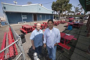 From left, Mike Redlew and Lawrence Maehara at Port of Long Beach's Berth 55 eatery.