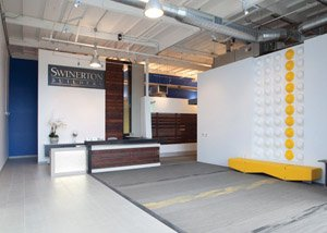 Swinerton Builders recently remodeled its office location in Rancho Bernardo to create a light-filled, net-zero building which includes a kitchen, outside patio and entertainment space.