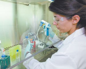 Amgen: A technician at the Thousand Oaks biotech works at a company lab.
