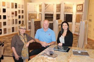 Cookie Wirtz, from left, John Wirtz and Amber Fox are part of the family business Wirtz Quality Installations Inc. Wirtz did the tile work in most of the common areas and patient bathrooms, and much of the exterior stone work at the new Palomar Medical Center.