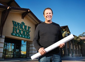 Jeffrey Essakow, CEO of Protea Properties LLC in La Jolla, stands in front of the Whole Foods market at the newly renovated Flower Hill Promenade in Del Mar. Protea owns the 35-year-old shopping center and invested $30 million in a makeover that includes 430 parking spaces tucked into an adjacent hillside and 70,000 square feet of new retail for a total of 173,000 square feet.