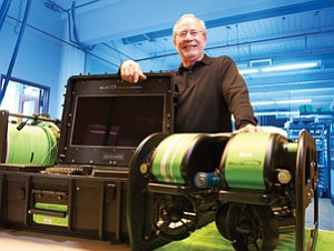 Don Rodocker, chairman and CEO of Seabotix Inc., stands in his Point Loma headquarters with the company's crawling undersea robot. The U.S. Government has purchased half of the company's production of the robots, which have capabilities important to military commanders.