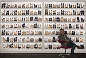 Brian Lee, chief executive of ShoeDazzle, with some of the online footwear vendor's products at the company's office in Santa Monica.