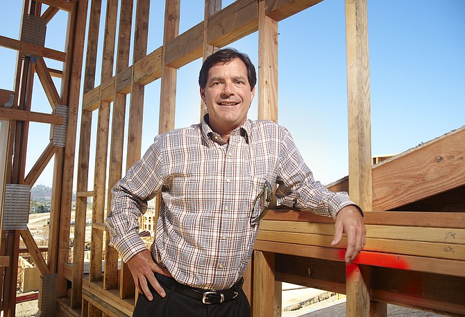 Paul Barnes, president of Shea Homes San Diego, stands on the construction site of Origen at Civita. Barnes says that his company closed on 200 single family homes in 2012 and expects that number to increase in 2013.