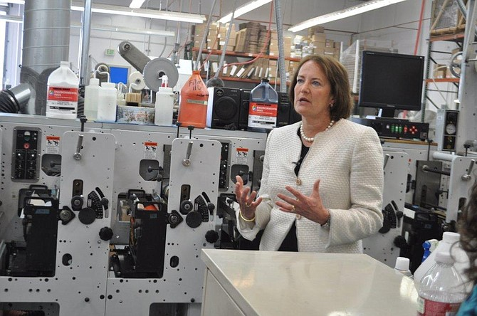 SBA Administrator Karen Mills visits Label King, a local SBA success story. Mills is proposing changes to the SBA loan process to make it more efficient.
