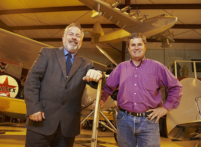 Peter Drinkwater, left, director of the San Diego County Airports Department stands with Willis Allen Jr. in the Allen Airways Flying Museum located at Gillespie Field in El Cajon. Gillespie Field is one of eight airports managed by the county.