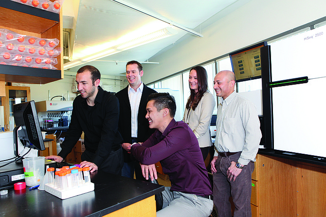 The Cypher Genomics team includes Adam Simpson, left, Ashley Van Zeeland, Ali Torkamani, Salil Deshpande and Phillip Pham. Van Zeeland earned a Ph.D. in neuroscience before studying at the Rady School of Management and starting Cypher Genomics with Torkamani and two other prominent business partners.