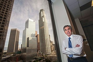 Russell Goldsmith wearing City National Bank's signature blue at its headquarters in downtown Los Angeles.