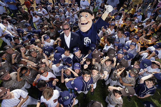 San Diego Padres President & CEO Tom Garfinkel and the Swinging Friar surrounded by hundreds of Little Padres at the Clairemont Hilltoppers Opening Day.