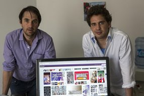 WhisperText founders Brad Brooks, left, and Michael Heyward in Santa Monica office.