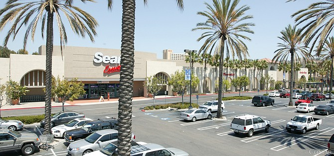 This Mission Valley building owned by Sears Holdings Corp., which most recently housed a Kmart store that is now closed, is being leased to furniture retailer Living Spaces, which will open by year's end, according to CBRE.