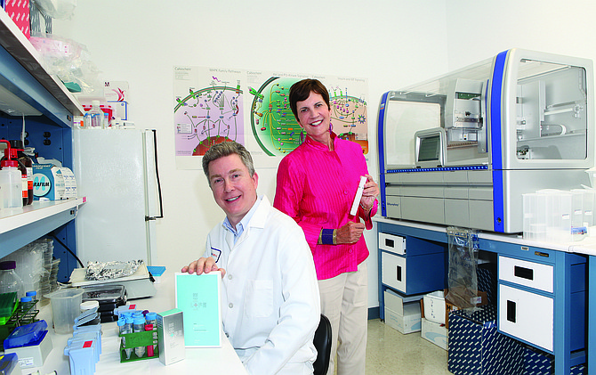 Simon Craw, left, and Donna Queen of Lifeline Skin Care Inc. are in the molecular biology laboratory. Lifeline is a wholly owned subsidiary of International Stem Cell Corp.