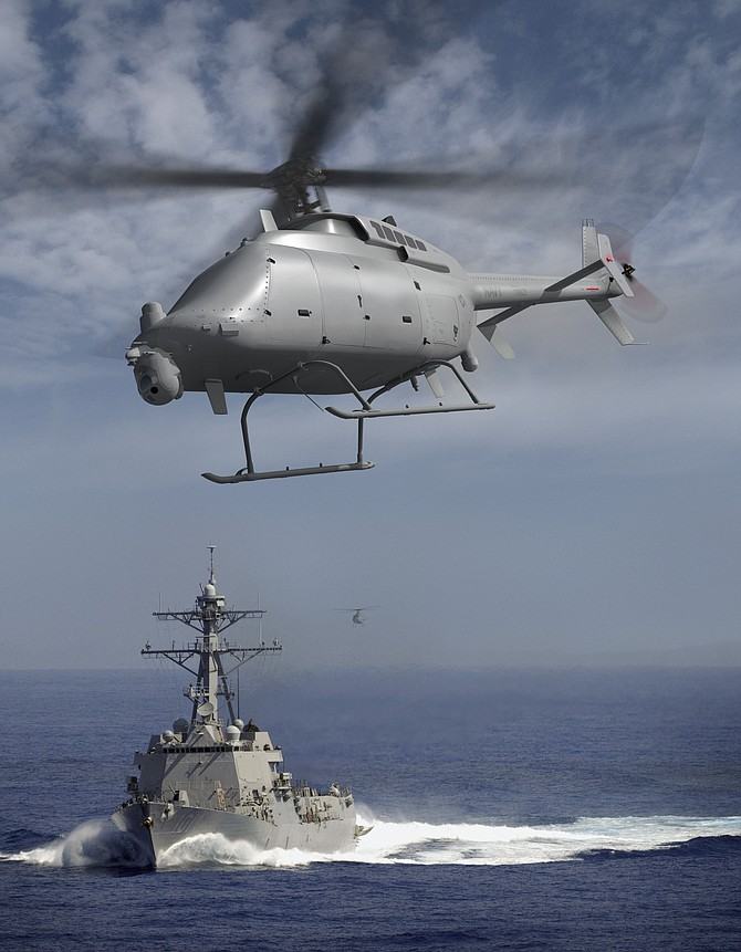 A photo illustration depicts a pair of Northrop Grumman's MQ-8 Fire Scouts accompanying a U.S. Navy ship. The unmanned aircraft is engineered in San Diego and is scheduled to make its first flight this summer.