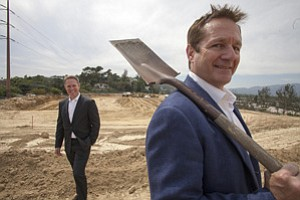 Charles Tourtellotte, right, of Taag Investment Partners and Jonathan Lee of George Smith Partners at the site of a Silver Lake condo project financed with an $11.8 million construction loan.