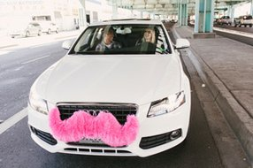 A Lyft car with moustache.