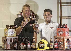 Robert Nowaczyk, left, and David Johnson with Fireman's Brew beer at the company's Canoga Park office.
