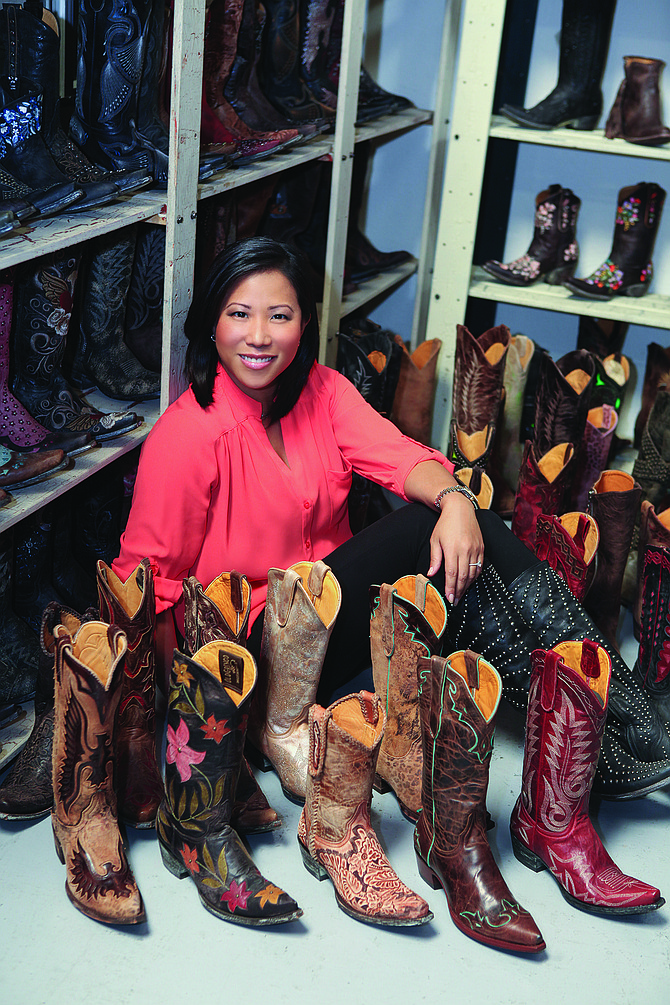 Jane Pak, president of San Diego's Old Gringo Boots Inc., displays some of the high-end boots the company produces at its facilities in Mexico and sells throughout the United States and on various websites.