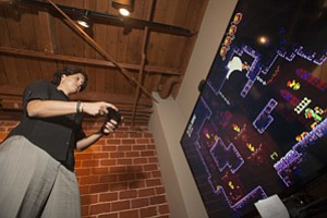 Chief Executive Julie Uhrman plays an Ouya game at the company's office in Santa Monica.