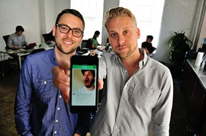 Tyler, left, and James McFadden show a Vine video at Collab in downtown Los Angeles.
