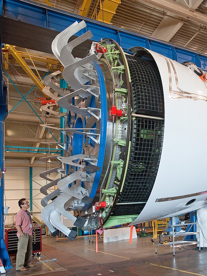 An employee observes an A350 XWB thrust reverser in a test rig at UTC Aerospace Systems - Aerostructures' Chula Vista site. It is the largest one the company has ever designed and built.