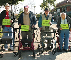 Protest: Four WWII veterans protest eviction from Twelve Oaks.