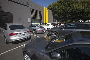 Parking lot for Cuningham Architecture Group in Culver City. Zoning rules limit the  amount of space that can be used for parking.