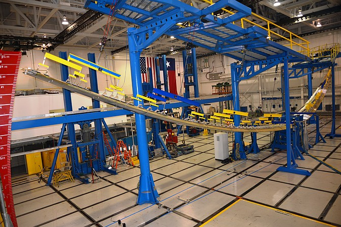 A Triton unmanned aircraft system wing structure is put through structural strength tests in late August by a Northrop Grumman/Triumph Aerostructures - Vought Aircraft Division engineering team.