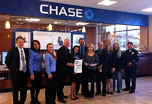 Los Angeles Councilman Tom LaBonge, fourth from left, at the 2012 opening of JPMorgan Chase Bank's branch in Toluca Lake.
