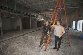 Chris Graves, left, and Paul Mareski at Team One's future HQ in Playa Vista.