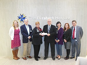 Left to right: Courteney O'Patry, Dr. Glenn Panzer, Jan Jones, Mark Polarek, Vatei Campbell, Liz Sumner and Kip Skavinski attended a check presentation for The Elizabeth Hospice.