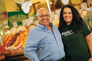 The Shemirani family — including founder and President Joe and daughter Rachel, pictured in the company's Point Loma store — operates Barons Market, which has four locations and a fifth set to open this year in Alpine.