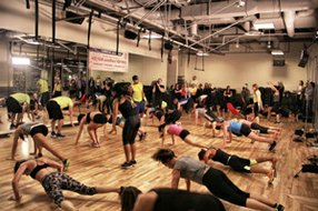 A Beachbody exercise program at a gym.